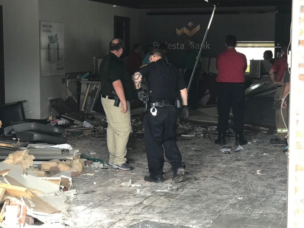 An SUV drove into the front of the Pedestal Bank in Breaux Bridge this morning.
