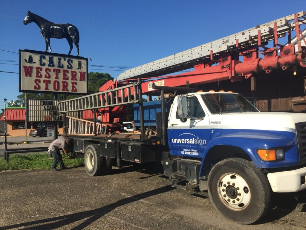 Crew preparing to remove the iconic sign.