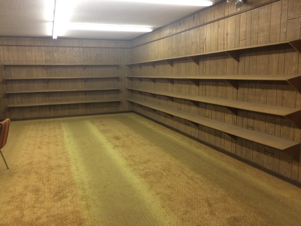 Empty shelves inside the former Cal's Western Store.