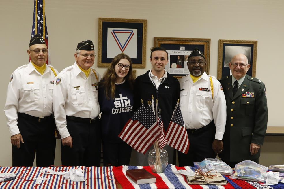 Hospice of Acadiana veterans and St. Thomas More students