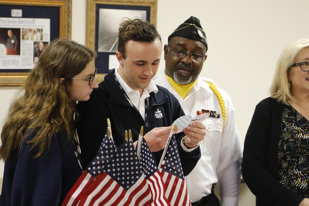 Hospice of Acadiana veteran and St. Thomas More students