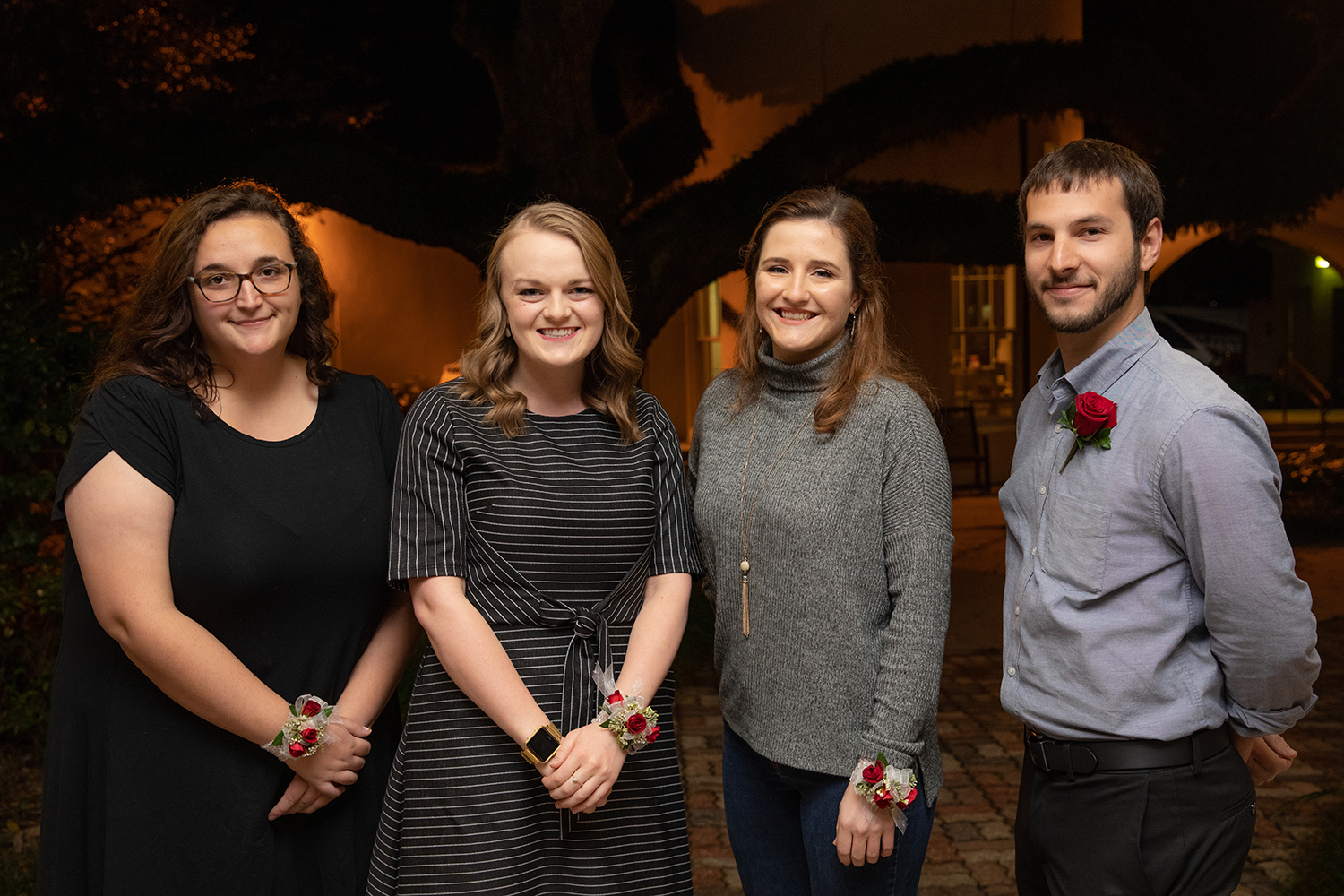 from left: Katie Murphy, School of Architecture and Design; Emily Covington, Department of Communication; Elizabeth Barron, Department of Biology; and Adam J. Trahan, Department of Physics. Caleb Fogle, Department of Psychology, is not pictured. (Photo credit: Rachel Keyes / University of Louisiana at Lafayette)