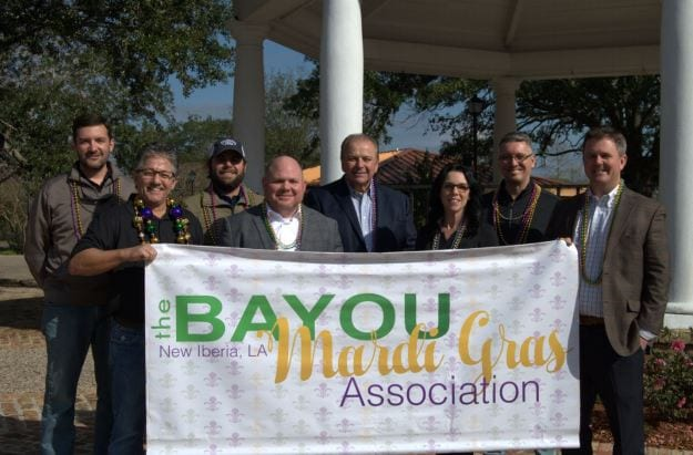 (Front Row L-R): Bayou Mardi Gras Assoc.Board Member Pat Norris, Musson Patout Vice President Bart Romero, Arceneaux Ford General Manager Kristie McMath Hebert, Bayou Mardi Gras Assoc. Board Member Beau Beaullieu, (Back Row L-R) Bayou Mardi Gras Board Member Mike Wattigny, Arceneaux Ford Sales Manager Travis McMath, Parade Grand Marshal Representative Taylor Barras, and Bayou Mardi Gras Assoc. Board Member Wess Robison