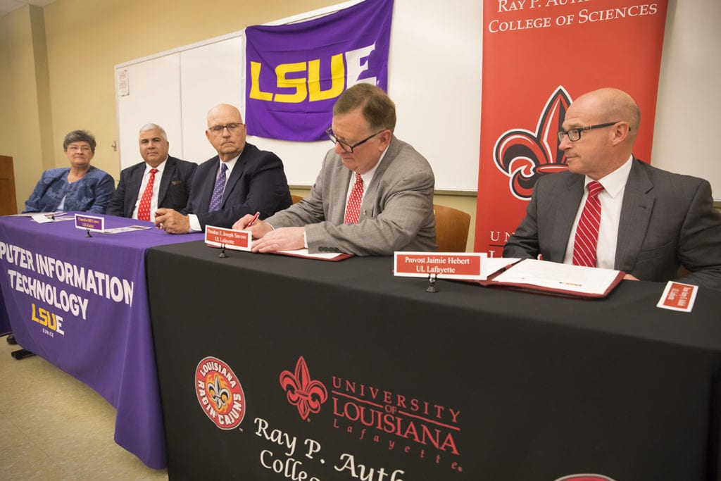 Photo caption:Administrators sign a transfer agreementThursday that will enable LSU Eunice grads to apply course credits toward earning a bachelor's degree in informatics at UL Lafayette. From left are Dorothy McDonald, dean of LSUE's Division of Health Sciences and Business Technology; Dr. Azmy S. Ackleh, dean of UL Lafayette's Ray P. Authement College of Sciences; Dr. William Crowe, LSUE's interim chancellor; Dr. Joseph Savoie, UL Lafayette president; and Dr. Jaimie Hebert, University provost and vice president for Academic Affairs. (Photo credit:Doug Dugas / University of Louisiana at Lafayette)