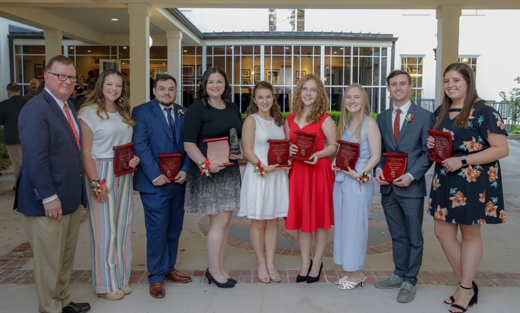 Photo caption: Dr. Joseph Savoie, UL Lafayette president (far left), with Spring 2019 Outstanding Graduates. The honorees are, from left: Hallie Dodge, College of Education; Zach Wells, B.I. Moody III College of Business Administration; Ada F. Tusa, Ray P. Authement College of Sciences; Sarah DiLeo, College of the Arts; Abigail Gatzy Morton, College of Liberal Arts; Theresa Sapera, College of Nursing and Allied Health Professions; Kyle Farmer, College of Engineering; and Haley Brooke Campbell, University College. (Photo credit: Rachel Keyes / University of Louisiana at Lafayette)