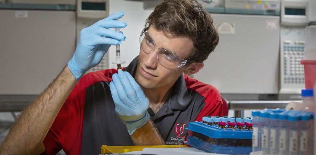 Photo caption: Graduate student Jacob LeBlanc works in an analytics laboratory in Madison Hall on UL Lafayette's campus. (Photo credit: Doug Dugas / University of Louisiana at Lafayette)
