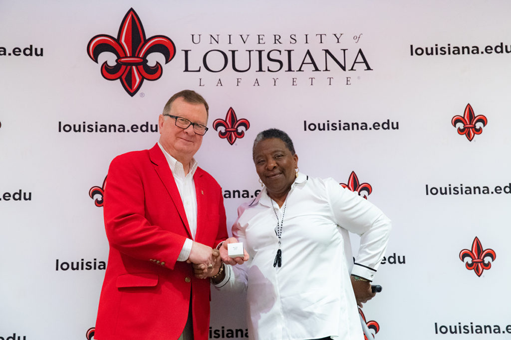 Photo:Linda Perkins Melton, a 68-year-old grandmother, is on track to earn a bachelor's degree in from the University of Louisiana at Lafayette next spring. Dr. Joseph Savoie, UL Lafayette president, recently presented Melton with her class ring during a ceremony in the UL Lafayette Student Union.Credit:Rachel Keyes / University of Louisiana at Lafayette